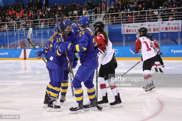 Sara Hjalmarsson of Sweden celebrates with teammates after scoring a goal in the third period against Japan during the Women's Ice Hockey Preliminary...