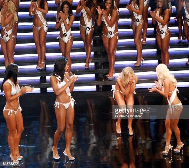 Sara Hoots celebrates on stage after winning the 12th Annual Hooters International Swimsuit Pageant at the Broward Center for the Performing Arts on...