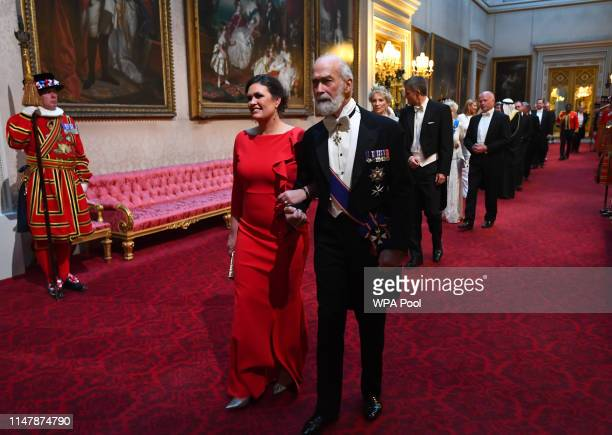 Sara Huckabee Sanders and Prince Michael of Kent arrive through the East Gallery for a State Banquet at Buckingham Palace on June 3, 2019 in London,...