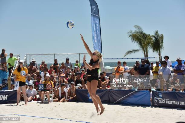 Sara Hughes of the University of Southern California serves against Pepperdine University during the Division I Women's Beach Volleyball Championship...