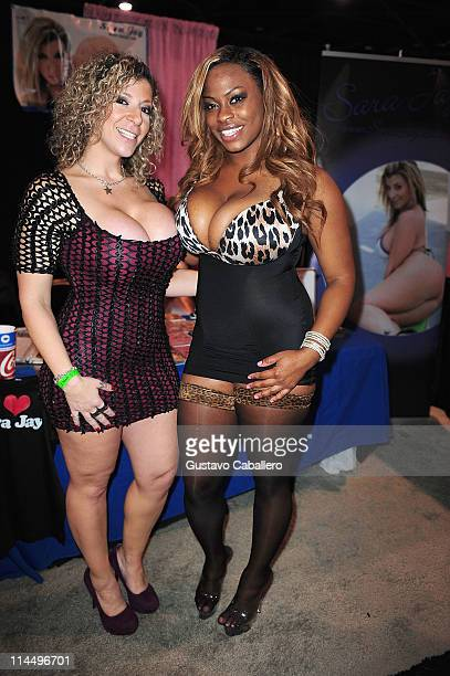 Sara Jay and Tori Taylor attend EXXXOTICA Miami Beach at the Miami Beach Convention Center on May 21 2011 in Miami Beach Florida