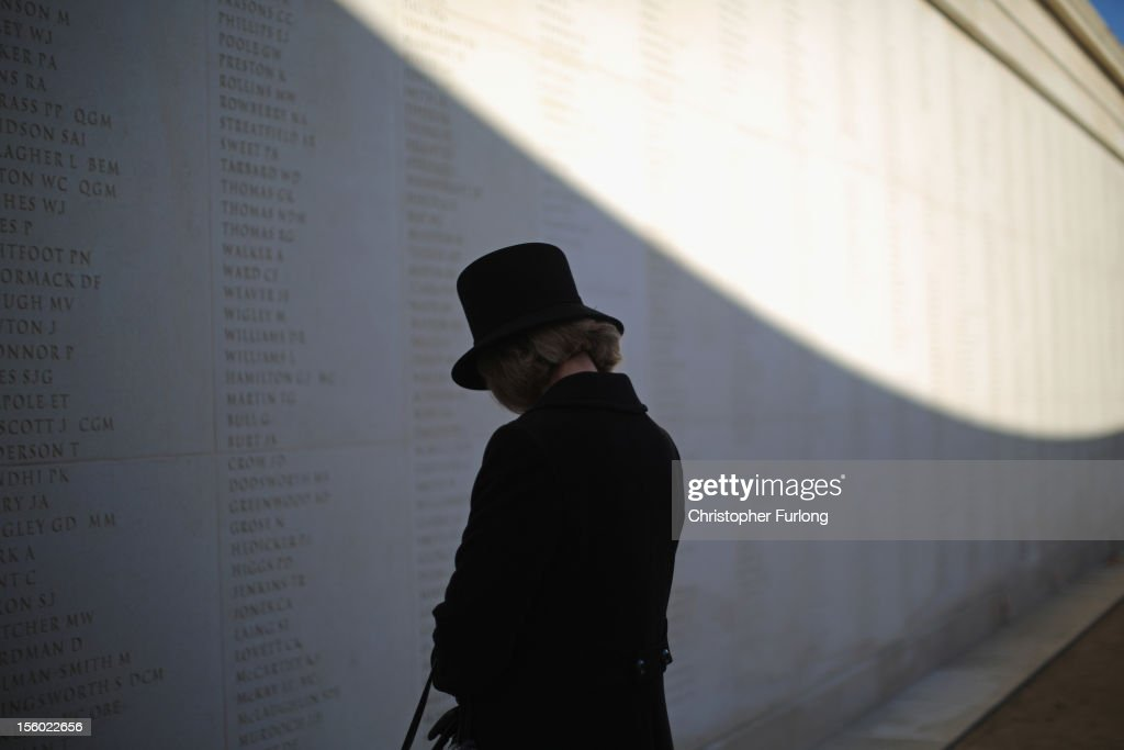 Sara Jones, CBE, the widow of Col 'H' Jones VC, pauses for thought as she looks at his name inscribed on the wall of Armed Forces Memorial at The National Arboretum during the remembrance Service on November 11, 2012 in Alrewas, England. The Armed Forces Memorial, is the UK's tribute to the men and women who have been killed on duty or as a result of terrorist action since 1948. Their names are inscribed on the giant Portland stone walls. The obelisk is specifically dedicated to those who have died whilst in service. The Armed Forces Memorial has been designed to allow a shaft of sunlight to fall across the sculpted wreath on the central stone on Armistice Day at precisely 11:00am on the 11th day of the 11th month, the time when fighting formally stopped in World War I.