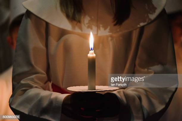 Sara Kjorling from Stockholm holds a candle as she leads the procession during the traditional Swedish festival of Sankta Lucia at York Minster on...
