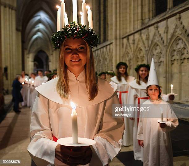 Sara Kjorling from Stockholm leads the procession during the traditional Swedish festival of Sankta Lucia at York Minster on December 11 2015 in York...