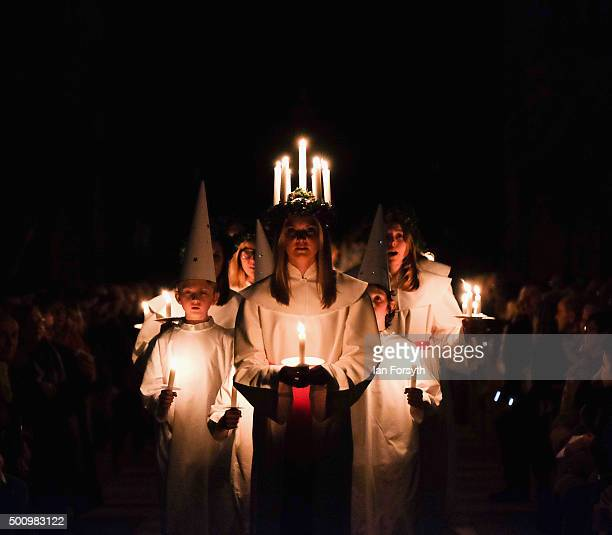Sara Kjorling from Stockholm leads the procession during the traditional Swedish festival of Sankta Lucia on December 11 2015 in York England The...