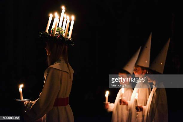 Sara Kjorling from Stockholm sings with three 'starboys' during the traditional Swedish festival of Sankta Lucia at York Minster on December 11 2015...