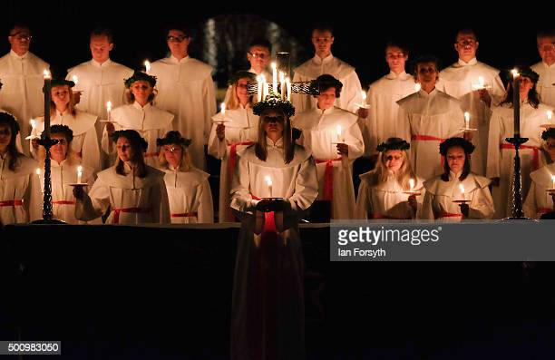 Sara Kjorling from Stockholm stands in front of the Chorus Pictor choir during the traditional Swedish festival of Sankta Lucia in York Minster on...