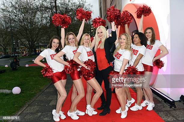 Sara Knappik poes with Cheerleaders during the TLC Station Launch Party on April 10 2014 in Munich Germany