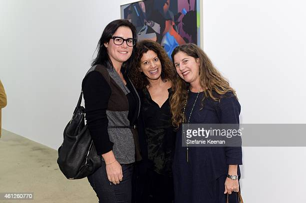 Sara Kohen Lori Ziegler and Andrea Feldman Falcione attend Opening Party For The New Steve Turner on January 9 2015 in Los Angeles California