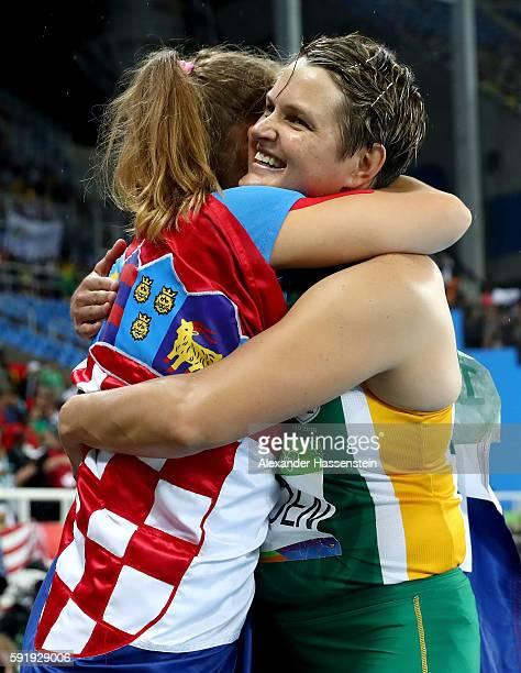 Sara Kolak of Croatia celebrates after winning gold with silver medalist Sunette Viljoen of South Africa after the Women's Javelin Final on Day 13 of...
