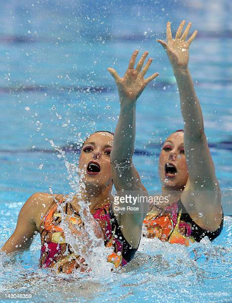 Sara Labrousse and Chloe Willhelm of France compete in the Duet Technical routine during the FINA Olympic Games Synchronised Swimming Qualification...