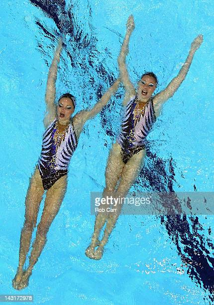 Sara Labrousse and Chloe Willhelm of France compete in the Duets Free routine during the FINA Olympic Games Synchronised Swimming Qualification at...