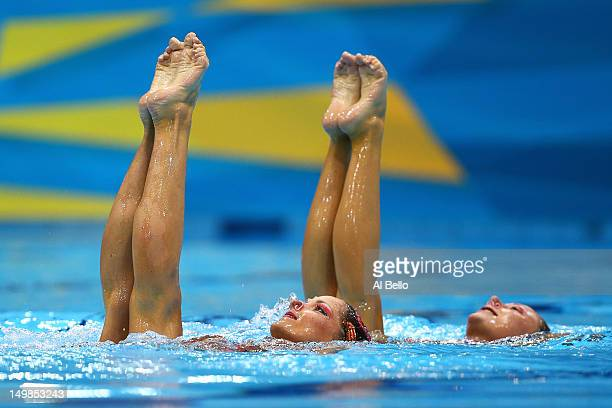 Sara Labrousse and Chloe Willhelm of France compete in the Synchronised Swimming Duets Technical Routine on Day 9 of the London 2012 Olympic Games at...