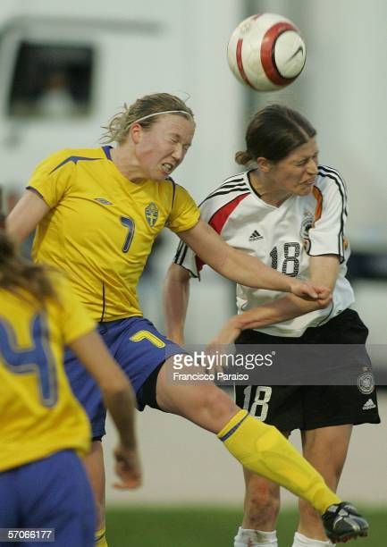 Sara Larson of Sweden tries a header against Kerstin Garefrekes of Germany during the Womens Algarve Cup match between Germany and Sweden on March...