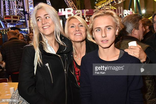 Sara Luna Leconte her mother Marie Sara Bourseiller and her brother Lalo Lambert attend the 'Jours de Fete au Grand Palais' Fete foraine Opening at...