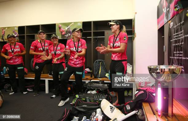 Sara McGlashan Sarah Coyte Kim Garth Alyssa Healy and Ellyse Perry of the Sixers sing the team song after winning the Women's Big Bash League final...