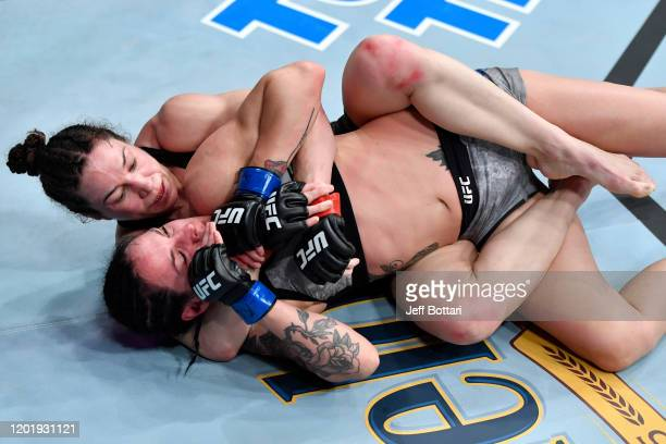 Sara McMann grapples with Lina Lansberg of Sweden in their women's bantamweight bout during the UFC Fight Night event at PNC Arena on January 25 2020...