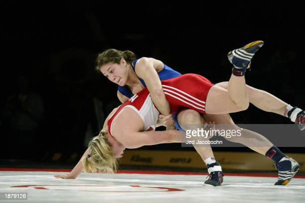 Sara McMann of the USA competes against Lene Aanes of Norway during the wrestling portion of the Titan Games at the Events Center at San Jose State...