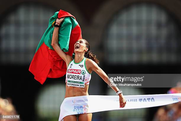Sara Moreira of Portugal celebrates as she crosses the finish line and wins the gold medal in the Half Marathon Women on day 5 of the 23rd European...