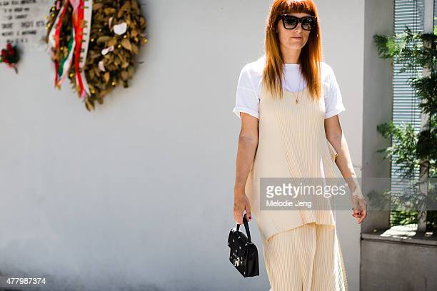 Sara Moschini wears a Stella McCartney outfit with a Frame Denim shirt Celine sunglasses and Jimmy Choo bag and shoes during Milan Men's Fashion Week...