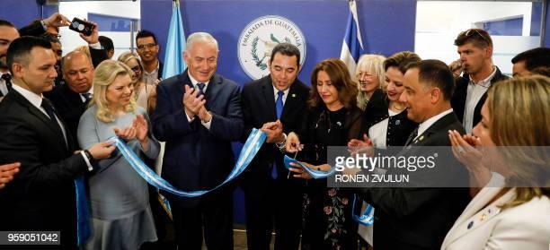 Sara Netanyahu and her husband Israeli Prime Minister Benjamin applaud as Guatemalan President Jimmy Morales and his wife Hilda Patricia Marroquin...