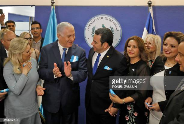 Sara Netanyahu and her husband Israeli Prime Minister Benjamin attend the inauguration ceremony of the Guatemalan embassy in Jerusalem with...