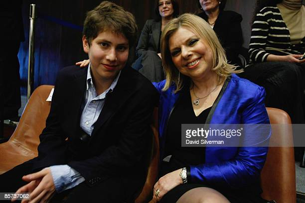 Sara Netanyahu wife of incoming Israeli Prime Minister Benjamin Netanyahu and their younger son Avner attend the session swearingin his new coalition...
