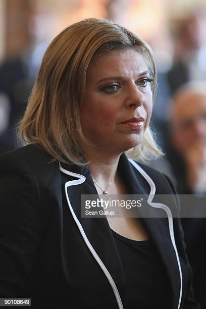 Sara Netanyahu wife of Israeli Prime Minister Benajmin Netanyahu attends a ceremony at which Bild newspaper head Kai Diekmann presented her husband...