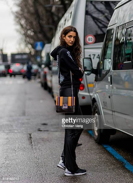 Sara Nicole Rossetto is wearing a Vetements hoody black leather pants and sneaker seen outside Giorgio Armani during Milan Fashion Week Fall/Winter...
