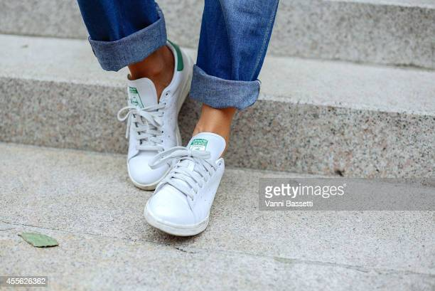 Sara Nicole Rossetto poses wearing a vintage overall and Adidas sneakers on September 17 2014 in Milan Italy