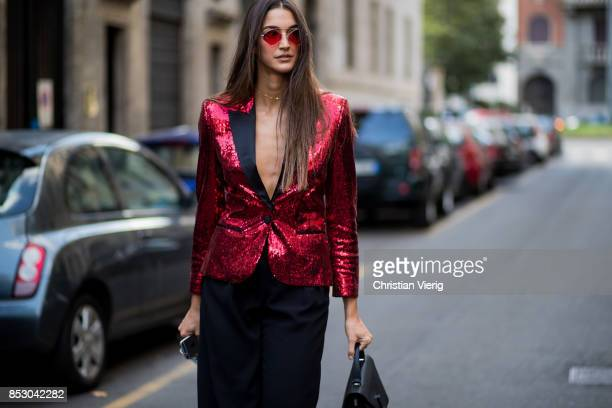 Sara Nicole Rossetto wearing red glitter blazer is seen outside Dolce Gabbana during Milan Fashion Week Spring/Summer 2018 on September 24 2017 in...
