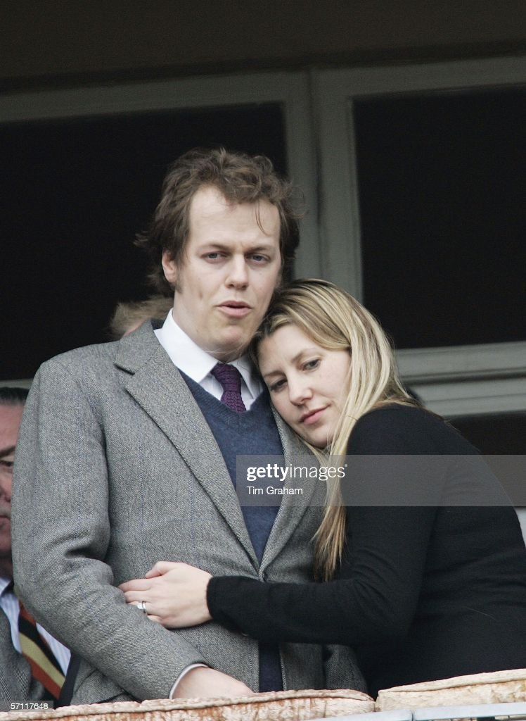 Sara Parker-Bowles hugs her husband Tom Parker-Bowles before the Gold Cup race on the fourth day of Cheltenham Races on March 17, 2006 in Cheltenham, England.