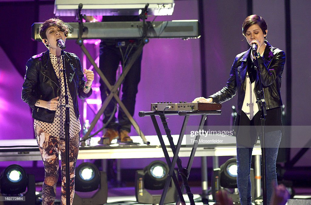Sara Quin (L) and Tegan Quin of Tegam and Sara perform at the mtvU Woodie Awards on March 14, 2013 in Austin, Texas.