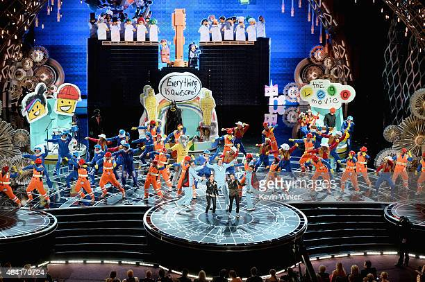 Sara Quin and Tegan Quin of 'Tegan and Sara' perform 'Everything Is Awesome' from 'The Lego Movie' onstage during the 87th Annual Academy Awards at...