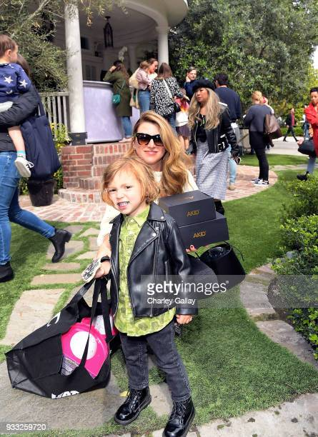 Sara Riff and son Theo Riff attend AKID Brand's 3rd Annual 'The Egg Hunt' at Lombardi House on March 17 2018 in Los Angeles California