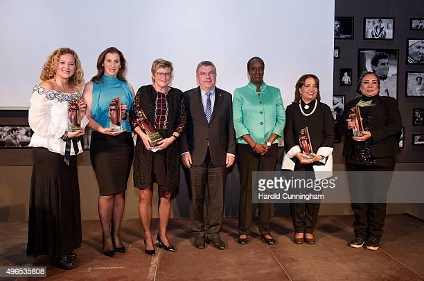 Sara Rosario Velez awarded IOC trophy for Americas Stavroula Kozompoli awarded IOC trophy for Euope New Zealand Olympic Committee General Secretary...