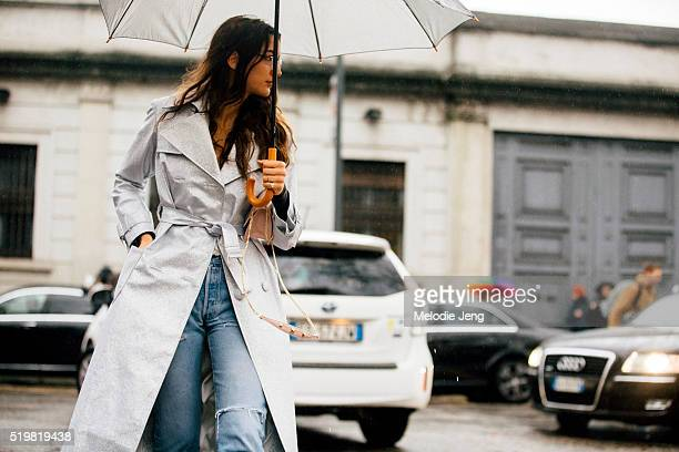 Sara Rossetto wears a silver trench coat in the rain at the Marni show during the Milan Fashion Week Fall/Winter 2016/17 on February 28 2016 in Milan...