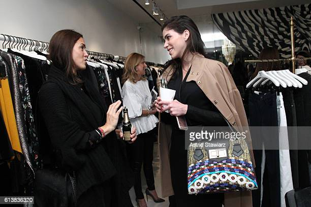 """Sara Roter and Alida Boer converse as Sara Blakely and Alice + Olivia celebrate the launch of """"The Belly Art Project"""" on October 10, 2016 in New York..."""