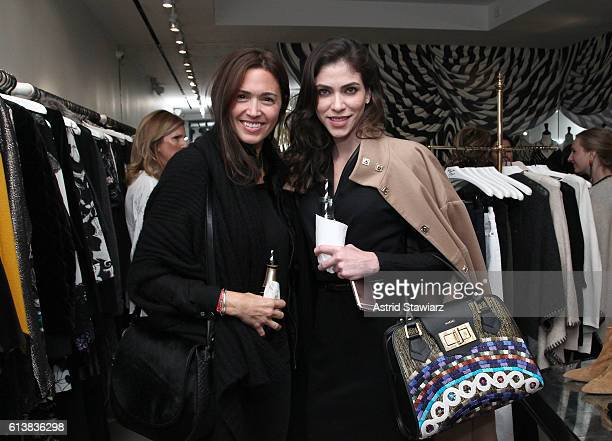 """Sara Roter and Alida Boer pose for a photo together as Sara Blakely and Alice + Olivia celebrate the launch of """"The Belly Art Project"""" on October 10,..."""