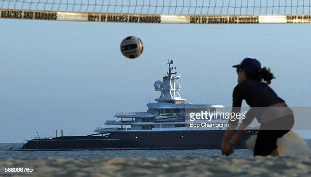 Sara Safadi jumps for the ball as she and friends play volleyball on Venice beach with the 377 foot long mega yacht the Luna owned by Russian...
