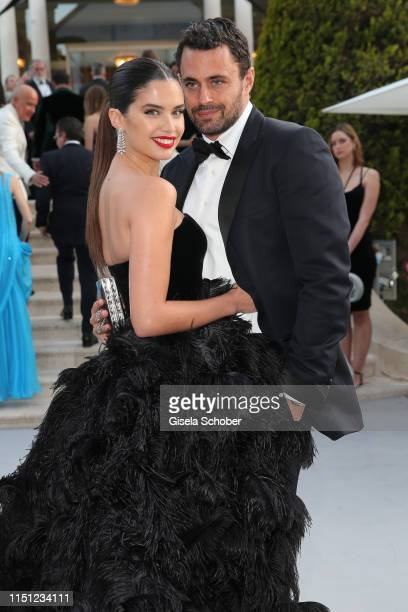 Sara Sampaio and Oliver Ripley attend the amfAR Cannes Gala 2019 at Hotel du CapEdenRoc on May 23 2019 in Cap d'Antibes France