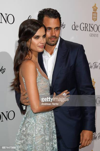 Sara Sampaio and Oliver Ripley attend the DeGrisogono 'Love On The Rocks' during the 70th annual Cannes Film Festival at Hotel du CapEdenRoc on May...