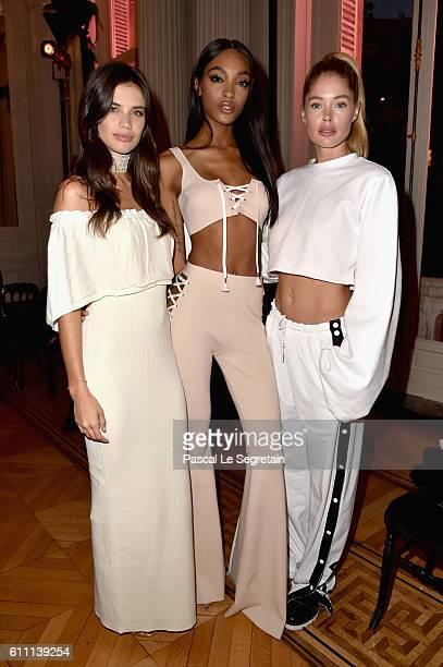 Sara Sampaio Jourdan Dunn and Doutzen Kroes attend FENTY x PUMA by Rihanna at Hotel Salomon de Rothschild on September 28 2016 in Paris France
