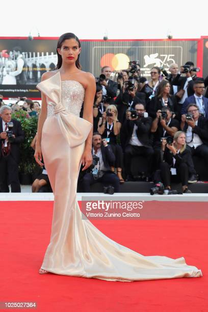 Sara Sampaio walks the red carpet ahead of the opening ceremony and the 'First Man' screening during the 75th Venice Film Festival at Sala Grande on...
