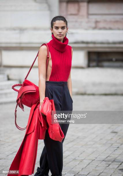 Sara Sampaio wearing a red turtleneck with side slit high waisted pants red heels is seen outside Balmain during Paris Fashion Week Spring/Summer...