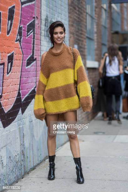 Sara Sampaio wearing a striped oversized knit seen in the streets of Manhattan outside Zadig Voltaire during New York Fashion Week on September 11...