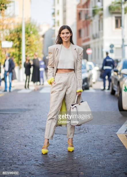 Sara Sampaio wearing creme pants coat and cropped top bag is seen outside Bottega Veneta during Milan Fashion Week Spring/Summer 2018 on September 23...
