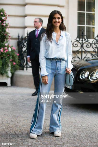 Sara Sampaio wears a blue shirt and blue jeans on September 29 2017 in Paris France