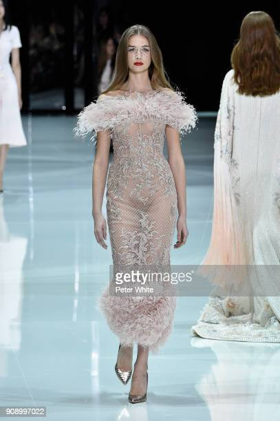 Sara Schuld walks the runway during the Ralph Russo Spring Summer 2018 show as part of Paris Fashion Week on January 22 2018 in Paris France