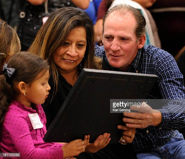 Sara Spence center admired a photo including her son Placido DeSantiago Thursday night with her granddaughter Gabby DeSantiago left and her husband...